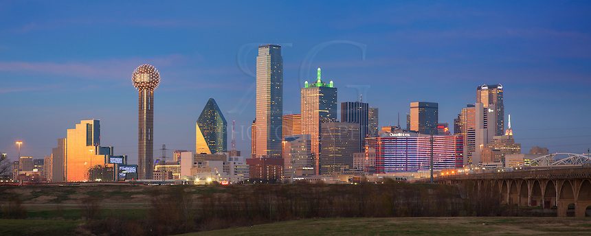 Just a few minutes after sunset, the faint high clouds briefly light up over the downtown Dallas skyline. Taken from near the Trinity River, this panorama shows some of the more well-known buildings of downtown including Reunion Tower, the Bank of the Americas Plaza, and the Omni Hotel.