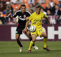 7 May 2005.  DC United's Ben Olsen (14) tries to keep  the ball away from Domenic Mediate (28) of the Columbus Crew at RFK Stadium in Washington, DC.