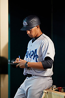Tampa Tarpons coach Jose Javier (20) in the dugout during a game against the Lakeland Flying Tigers on April 5, 2018 at Publix Field at Joker Marchant Stadium in Lakeland, Florida.  Tampa defeated Lakeland 4-2.  (Mike Janes/Four Seam Images)