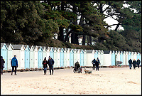 BNPS.co.uk (01202 558833)<br /> Pic:  RogerArbon/BNPS<br /> <br /> A group of hardy souls combined two great British traditions to queue out overnight to secure a sought-after beach hut for the summer.<br /> <br /> Some 21 of the timber cabins at Avon Beach, Christchurch, Dorset, became available to rent for the whole year from 8am today.<br /> <br /> The huts are in such demand that people began queuing from 7.30am yesterday (Sun) to guarantee one.<br /> <br /> The stoic group swelled in size throughout the day and night when temperatures dropped to a freezing 2C.