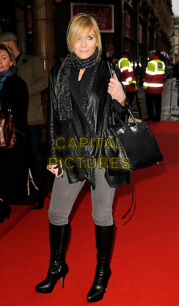 """MICHELLE COLLINS .At the UK Film Premiere of """"The Secret Of Moonacre"""" Vue West End, Leicester Square, London, England, .25th January 2009..full length black bag leather jacket knee high boots scarf grey gray jeans .CAP/CAN.©Can Nguyen/Capital Pictures"""