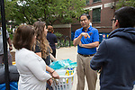 DePaul President A. Gabriel Esteban, Ph.D.,  talks with freshman Viviana Campos during Move In Day. Her mom Norma and brother Adrian came along to help her move.  Photo by Diane M. Smutny