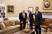 United States President Barack Obama jokes with Vice President Joe Biden and former Secretary of State Colin Powell following their meeting in the Oval Office,  December 1, 2010..Mandatory Credit: Pete Souza - White House via CNP