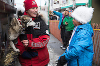 Aliy Zirkle talks to 9 year old Adara Clemons in the staging area prior to the ceremonial start of the Iditarod sled dog race in downtown Anchorage Saturday, March 2, 2013. ..Photo (C) Jeff Schultz/IditarodPhotos.com  Do not reproduce without permission