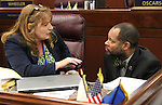 Nevada Assembly Minority Leader Marilyn Kirkpatrick, D-North Las Vegas, and Senate Minority Leader Aaron Ford, D-Las Vegas, talk on the Assembly floor at the Legislative Building in Carson City, Nev., on Friday, May 22, 2015. <br /> Photo by Cathleen Allison