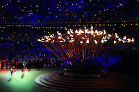 PICTURE BY ALEX BROADWAY /SWPIX.COM - 2012 London Paralympic Games - Day Eleven - Closing Ceremony, Olympic Stadium, Olympic Park, London, England - 09/09/12 - The Paralympic flame is extinguished by Eleanor Simmonds and Jonnie Peacock of Great Britain.