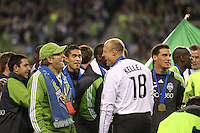 Kasey Keller (18 ) of the Seattle Sounders FC celebrates with owner Drew Carrey. The Seattle Sounders FC defeated the Columbus Crew 2-1 during the US Open Cup Final at Qwest Field in Seattle,WA, on October 5, 2010.