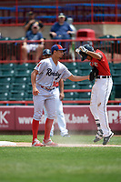Reading Fightin Phils relief pitcher Mario Sanchez (30) tags out a runner during a game against the Erie SeaWolves on May 18, 2017 at UPMC Park in Erie, Pennsylvania.  Reading defeated Erie 8-3.  (Mike Janes/Four Seam Images)