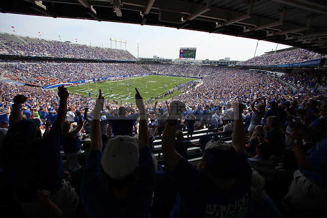 Fans cheer after Kentucky scored their third touchdown during the first half of the University of Kentucky vs. University of Tennessee Martin football game at Commonwealth Stadium in Lexington, Ky., on Saturday, August 30, 2014. This is the first game of the 2014 football season. Photo by Tessa Lighty | Staff
