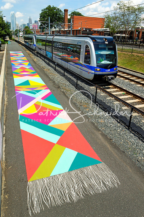Photography of the Magic Carpet Mural along the Queen City&rsquo;s Rail Trail along  the LYNX Blue Line in the Southend of Charlotte, North Carolina.<br /> <br /> The LYNX Blue Line is the Charlotte region&rsquo;s first light rail service. It is 9.6 miles long and operates from I-485 at South Boulevard to Uptown Charlotte. <br /> <br /> Charlotte Photographer - PatrickSchneiderPhoto.com