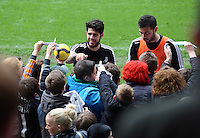 Wednesday, 23 April 2014<br /> Pictured L-R: Alejandro Pozuelo and Jordi Amat signing autographs for supporters.<br /> Re: Swansea City FC are holding an open training session for their supporters at the Liberty Stadium, south Wales,