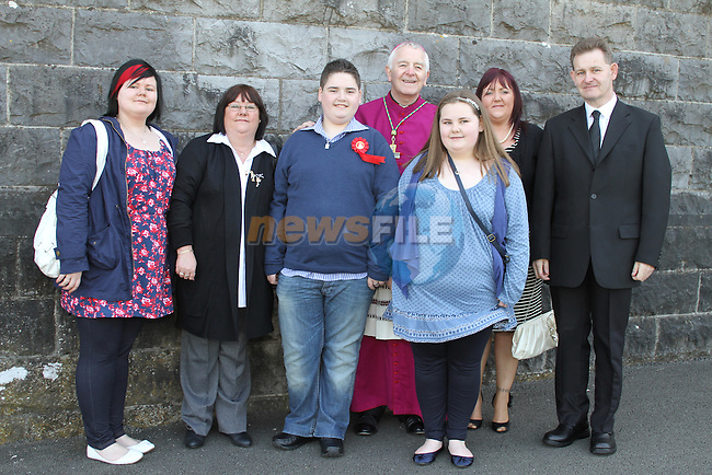 Michael Devine with his family at Tullyallen NS. Confirmation....(Photo credit should read Jenny Matthews www.newsfile.ie)....This Picture has been sent you under the conditions enclosed by:.Newsfile Ltd..The Studio,.Millmount Abbey,.Drogheda,.Co Meath..Ireland..Tel: +353(0)41-9871240.Fax: +353(0)41-9871260.GSM: +353(0)86-2500958.email: pictures@newsfile.ie.www.newsfile.ie.