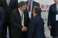 Gang Yi (L) governor of People's Bank of China and Hungarian Prime Minister Viktor Orban (R) shake hands after the opening ceremony of the 16+1 China-CEEC Central Bank Governors' Meeting in Budapest, Hungary on Nov. 9, 2018. ATTILA VOLGYI