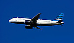 30 June 2007: A Jet Blue Airbus 320 jet flies over Historic Centennial Field in Burlington, Vermont. ..Mandatory Photo Credit: Ed Wolfstein Photo