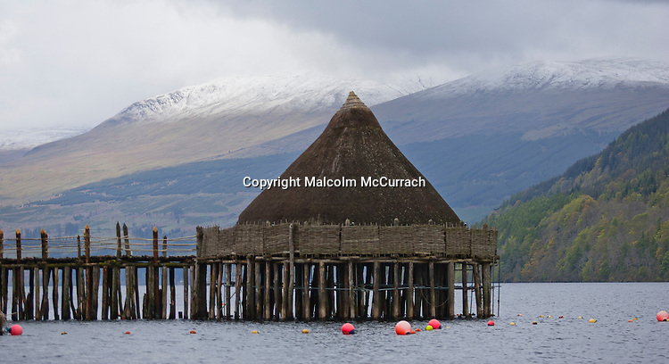 A Crannog situated in Loch Tay, Scotland.  <br /> <br /> Crannogs are ancient loch-dwellings found throughout Scotland and Ireland. Most are circular structures, built as individual homes to accommodate extended families.