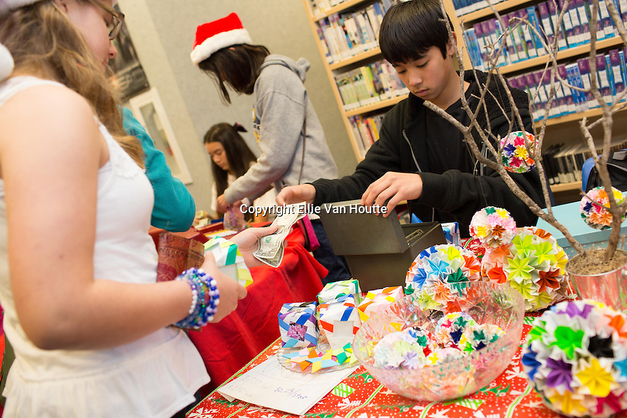 Grant Nieda sells origami ornaments at the holiday faire.