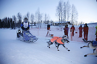 Sunday, February 25th, Willow, Alaska.  Jr. Iditarod musher Rohn Buser crosses the finish line in  1st  place