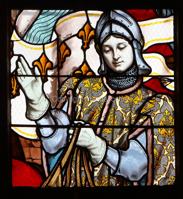 St Joan of Arc entering Orleans with her standard, saying she has been called by God to free the town, from a series of 19th century stained glass windows by Galland and Gibelin illustrating the life of Joan of Arc, in the nave of Orleans Cathedral, or the Basilique Cathedrale Sainte-Croix d'Orleans, built in Gothic style 1278-1329 and largely rebuilt 1601-1829 after it was partially destroyed in 1568, in Orleans, Loiret, Centre, France. The cathedral is listed as a historic monument. Picture by Manuel Cohen