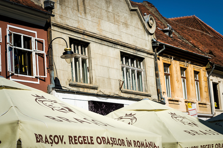 View of typical facades of historic buildings at the pedestrian Strada Replubicii street  in Brasov, Romania