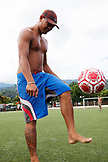FRENCH POLYNESIA, Tahiti, Papeete. A soccer game between locals at the Willy Bambridge Stadium. A young soccer player playing with the ball.