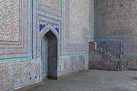 Detail of corner and doorway with majolica tiling, winter mosque, Kukhna Ark, Khiva, Uzbekistan, pictured on July 7, 2010, in the morning. The Kukhna Ark is the original home of the Khans. Although its foundations are 5th century, most of the complex is 19th century. Khiva, ancient and remote, is the most intact Silk Road city. Ichan Kala, its old town, was the first site in Uzbekistan to become a World Heritage Site(1991). Picture by Manuel Cohen.