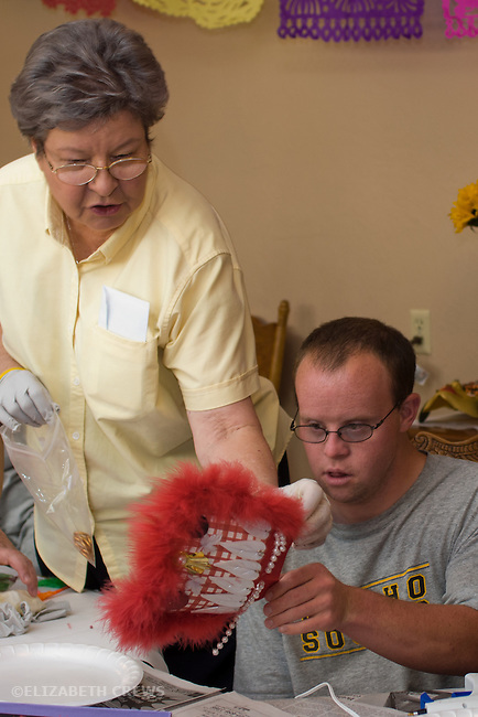 Concord, CA, Intellectually handicapped young man being helped with mask-making at his residential home MR