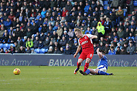 Fleetwood Town's Kyle Dempsey (left)  is tackled by Oldham Athletic's Anthony Gerrard during the Sky Bet League 1 match between Oldham Athletic and Fleetwood Town at Boundary Park, Oldham, England on 26 December 2017. Photo by Juel Miah / PRiME Media Images.