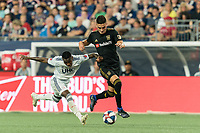 FOXBOROUGH, MA - AUGUST 4: Eduard Atuesta #20 of Los Angeles FC dribbles as Luis Caicedo #27 of New England Revolution defends during a game between Los Angeles FC and New England Revolution at Gillette Stadium on August 3, 2019 in Foxborough, Massachusetts.