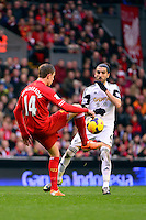 Sunday, 23 February 2014<br /> Pictured: Liverpool's Jordan Henderson competes with Swansea City's Chico Flores<br /> Re: Barclay's Premier League, Liverpool FC v Swansea City FC v at Anfield Stadium, Liverpool Merseyside, UK.