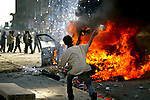 A riot ensues following a suicide car bomb in central Baghdad on June 14, 2004.  The blast killed at least twelve and wounded forty others.  (photo by Khampha Bouaphanh)
