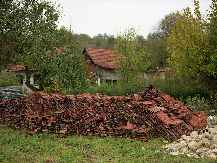 Roof tiles stacked in a field in North-West Bosnia - part of the extensive post-war re-building program.