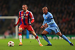 Franck Ribery of Munich and Fernando of Manchester City - Manchester City vs. Bayern Munich - UEFA Champion's League - Etihad Stadium - Manchester - 25/11/2014 Pic Philip Oldham/Sportimage