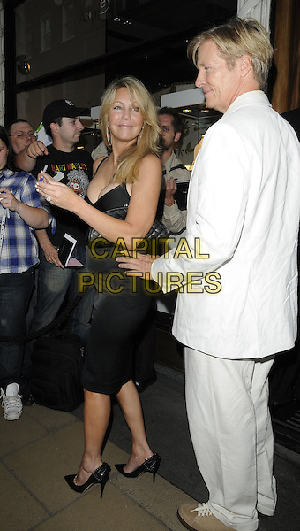 "HEATHER LOCKLEAR & JACK WAGNER .""Shooting Stars Benefit pairing dinner"", Asprey, New Bond St., London, England..August 3rd, 2011 .full length black dress white suit ream shirt couple side profile.CAP/CAN.©Can Nguyen/Capital Pictures."