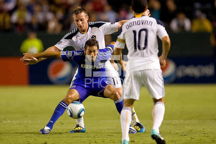 Davy Arnaud of the Kansas City Wizards defending his space holding the ball. The Kansas City Wizards beat the LA Galaxy 2-0 at Home Depot Center stadium in Carson, California on Saturday August 28, 2010.