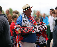 Pictured: Souvenir scarf sellers outside the Old Trafford. Saturday 16 August 2014<br />