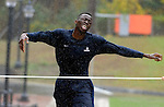 Amida Brimah, with a final push as he hits the finish line in a steady rain, during the Huskie Run,  Wednesday, Oct. 1, 2014, at the University of Connecticut. (Jim Michaud / Journal Inquirer)