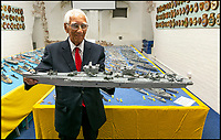 BNPS.co.uk (01202 558833)Pic: LeeMcLean/BNPS<br /> <br /> Master matchstick modeller Philip Warren (87) with his 3ft replica of HMS Queen Elizabeth, which took him eight months to create.<br /> <br /> Master modeller Philip Warren has spent 70 years building an incredible fleet of 484 warships and he says he is not ready to sail into the sunset.<br /> <br /> Philip, 87, has dedicated his entire adult life to crafting the matchstick armada and has built every class of ship in the Royal Navy since 1945, using over a million matchsticks.<br /> <br /> He recently completed a magnificent 3ft replica of the HMS Queen Elizabeth aircraft carrier which took him eight months.