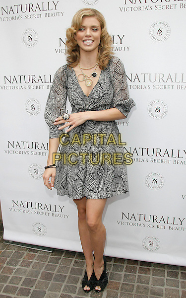 ANNALYNNE McCORD .at The launch of the new natural bath and body collection Naturally Victoria's Secret held at Victoria's Secret at The Grove in Los Angeles, California on March 21st 2009.                                                                     .full length black and white print dress sleeves peep toe shoes booties ring .CAP/DVS.©RockinExposures/Capital Pictures