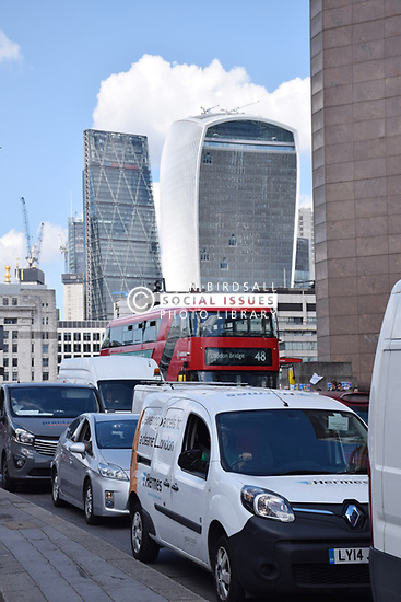 Traffic on London Bridge.  In the background: City of London - 20 Fenchurch Street (Walkie Talkie building) and The Leadenhall Building (The Cheesegrater), London 2017