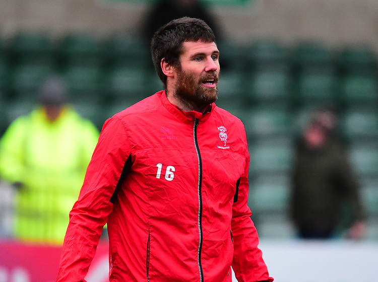 Lincoln City's Michael Bostwick during the pre-match warm-up<br /> <br /> Photographer Andrew Vaughan/CameraSport<br /> <br /> The EFL Sky Bet League Two - Saturday 15th December 2018 - Lincoln City v Morecambe - Sincil Bank - Lincoln<br /> <br /> World Copyright © 2018 CameraSport. All rights reserved. 43 Linden Ave. Countesthorpe. Leicester. England. LE8 5PG - Tel: +44 (0) 116 277 4147 - admin@camerasport.com - www.camerasport.com