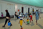 Women and kids hang out near their caravan rooms, in a women-children detention facility within Ketziot Prison compound, designated for African asylum-seekers who have illegally crossed the nearby Egyptian-Israeli border.