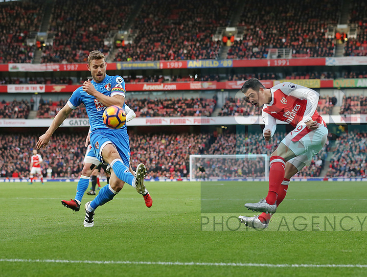 Arsenal's Granit Xhaka tussles with Bournemouth's Simon Francis during the Premier League match at the Emirates Stadium, London. Picture date October 26th, 2016 Pic David Klein/Sportimage