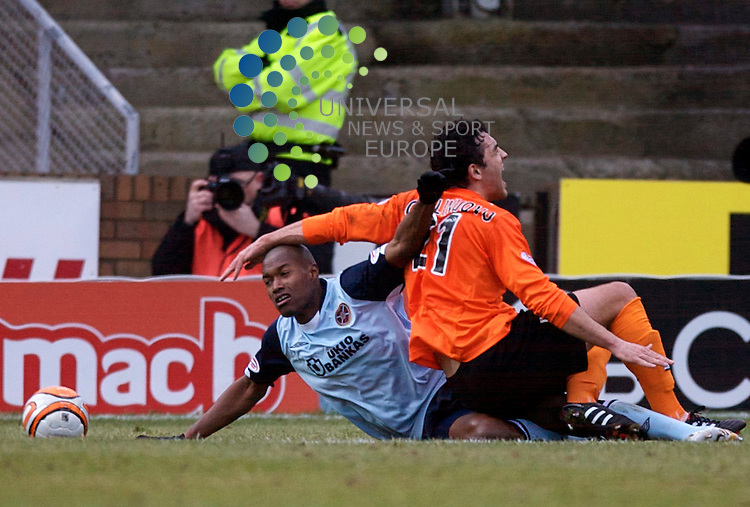 Scottish Clydesdale Bank Premier League, Championship Season 2009/10.Dundee United Football Club  V Heart Of Midlothian Football Club... Hearts Jose Goncalves ploughs in to Dundee United's Damien Casalinuovo   , in today's thrilling and must win game for both sides, With United need ing the points to regain 3rd Spot in the table and Hearts needing the points for a possible European place In the Clydesdale Bank Scottish Premier League encounter between Dundee United and Hearts..At Tannadice Park Stadium, Dundee...Picture, Mark Davison/Universal News and Sport .