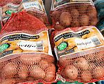 Bags of Scottish Maris Peer  second early seed potatoes on sale Ladybird Nurseries garden centre, Gromford, Suffolk, England, UK