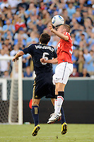 Tom Cleverley (35) of Manchester United and Stefani Miglioranzi (6) of the Philadelphia Union go up for a header. Manchester United (EPL) defeated the Philadelphia Union (MLS) 1-0 during an international friendly at Lincoln Financial Field in Philadelphia, PA, on July 21, 2010.