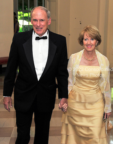United States Senator Daniel Coats (Republican of Indiana) and his wife, Marsha, arrive for a State Dinner in honor of Chancellor Angela Merkel of Germany at the White House in Washington, D.C.  on Tuesday, June 7, 2011..Credit: Ron Sachs / CNP