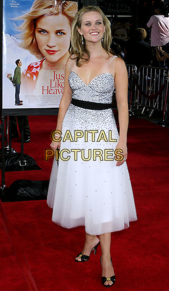 "REESE WITHERSPOON.At the Los Angeles Premiere of ""Just Like Heaven"" held at Graumann's Chinese Theatre,.Los Angeles, 8th Septeber 2005.full length black white layer chiffon dress crystal earrings alice hair band belt clutch bag open toe sandals.Ref: ADM/JW.www.capitalpictures.com.sales@capitalpictures.com.© Capital Pictures."