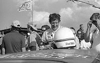 Driver Paul Miller climbs from his race car after an 11th place finish in the 24 Hour Pepsi Challenge at Daytona Internatonal Speedway, Daytona Beach, FL, January 30-31, 1982.  (Photo by Brian Cleary/www.bcpix.com)