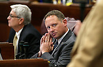 Nevada Assembly members, from left, Erven Nelson and Mike Sprinkle work on the Assembly floor at the Legislative Building in Carson City, Nev., on Wednesday, April 1, 2015. <br /> Photo by Cathleen Allison