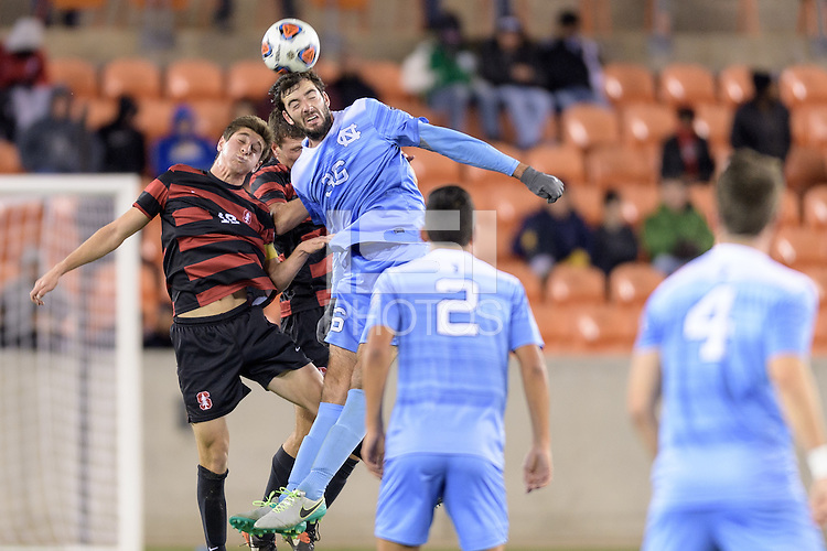 Houston, TX - Friday December 9, 2016:Tucker Hume (26) of the North Carolina Tar Heels wins a header over Drew Skundrich (12) of the Stanford Cardinal at the NCAA Men's Soccer Semifinals at BBVA Compass Stadium in Houston Texas.